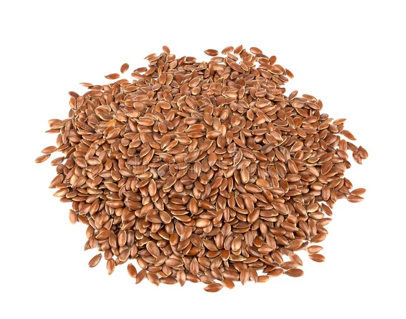Linseed on a white background. Also known as Linseed, Flaxseed a. Flax seeds isolated on white background. Also known as Linseed, Flaxseed and Common Flax. Pile stock photos