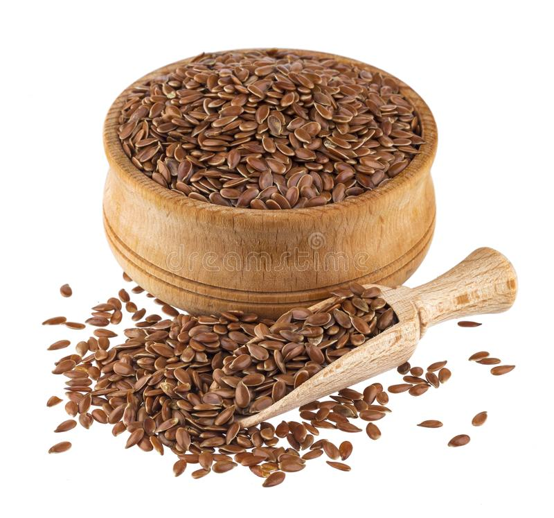Linseed in wooden scoop and bowl isolated on white background royalty free stock images
