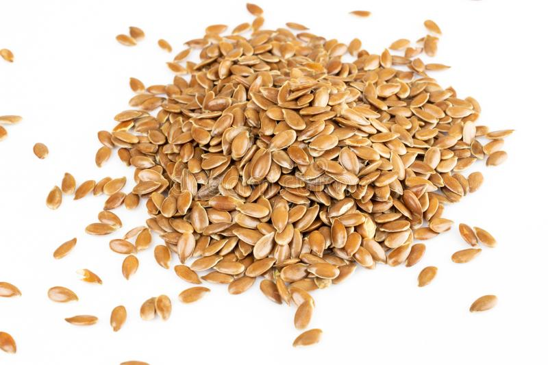 Some linseeds, Flax seeds, spread out on white background. Diet and healthy eating concept. royalty free stock photo