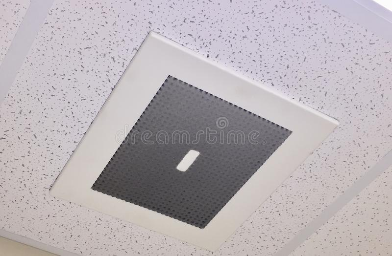 Lint and Dust on a vent cover. A air conditioning and heating system vent cover that is covered in dirt, dust and lint stock photography