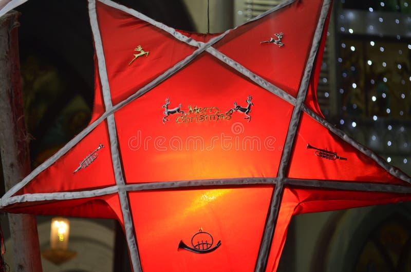 Linterna de la estrella de la Feliz Navidad foto de archivo