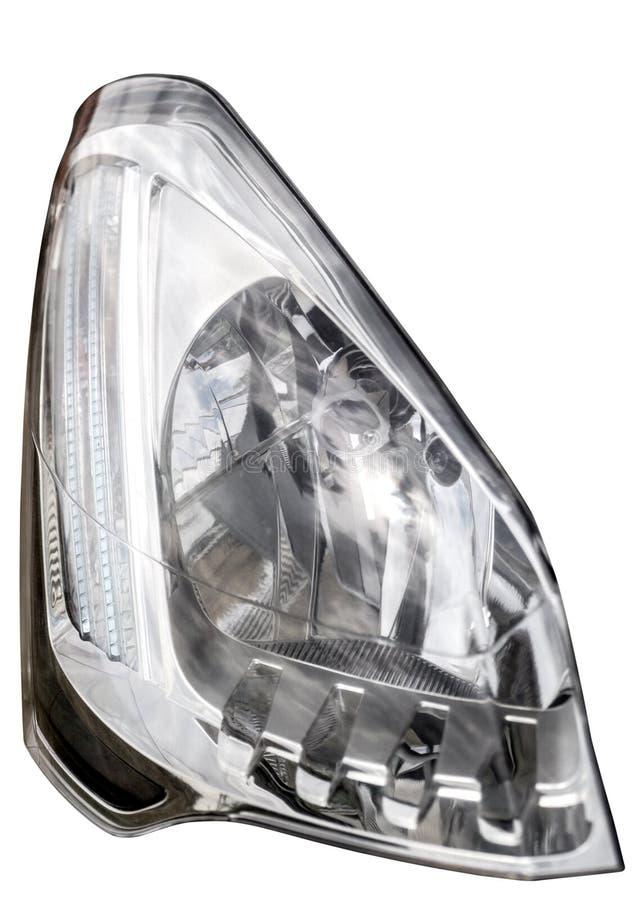Linterna del primer del coche, aislada en el fondo blanco, con el cli imagen de archivo