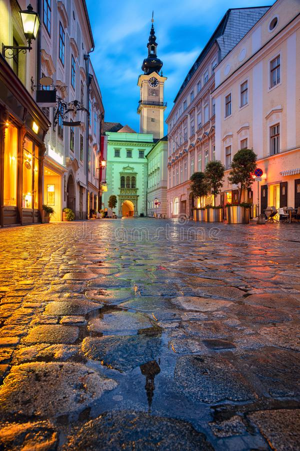 Linz, Austria. Cityscape image of old town Linz, Austria during twilight blue hour with reflection of the city lights royalty free stock photos