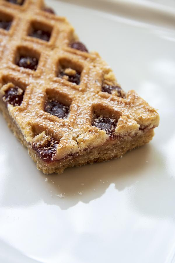 Linzer Torte is traditional Austrian cake with a lattice design on top of the pastry. stock photo