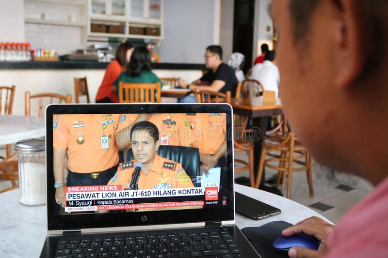 Lion Air JT 610 Falls in Indonesia. A resident watched the live broadcast of the fall of Lion Air JT 610 on a laptop in Makassar, Indonesia, Monday, October 29 stock photo