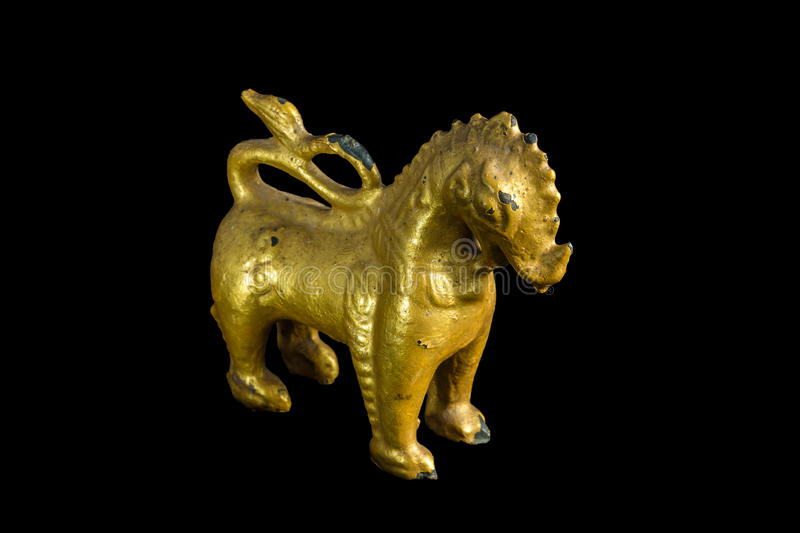 Lion ancient statue - Golden lion statue in Thai style with isolated on black background. stock image