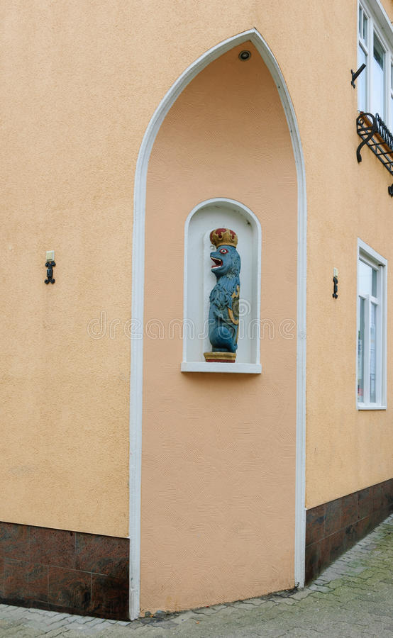 Lion as wooden figure in a niche. In the old town of Kappeln, Schleswig-Holstein royalty free stock images