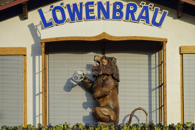 Oktoberfest beer festival in Munich, Germany. Lion with beer mug on the Loewenbraeu Beer Tent at Oktoberfest in Munich, Bavaria, Germany royalty free stock image