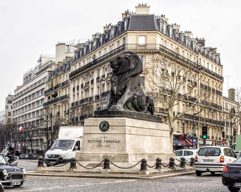 The Lion of Belfort. Is a bronze sculpture by Auguste Bartholdi situated at the middle of the square of Place Denfert-Rochereau in Paris, near the catacombs. It stock photos