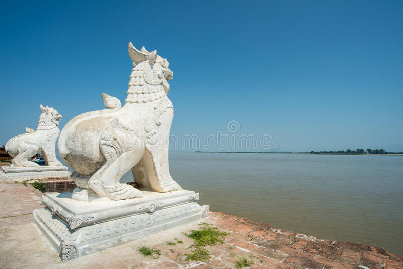 The Lion in Burmese style and Ayeyarwady River, Myanmar. royalty free stock photography