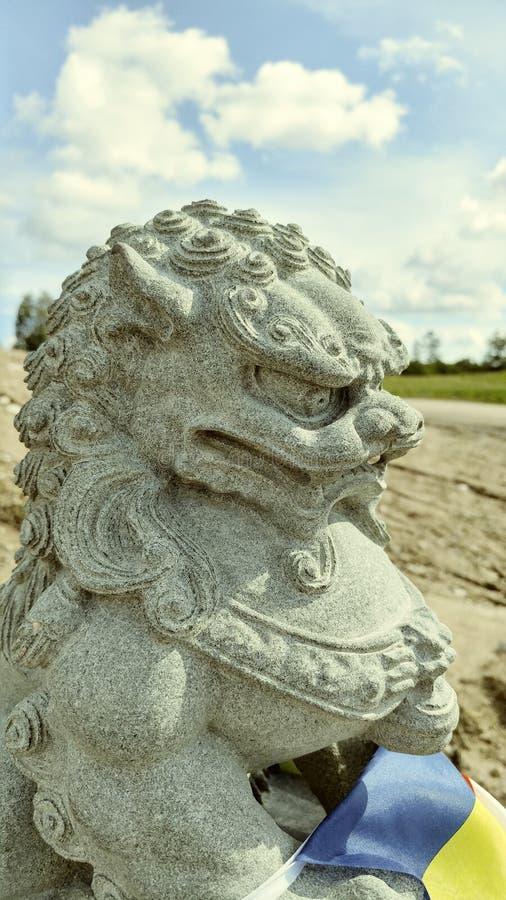 Lion chinois en pierre images stock