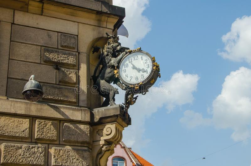 Lion with clock sculpture in the centrum of Klodzko, Poland. In spring stock images
