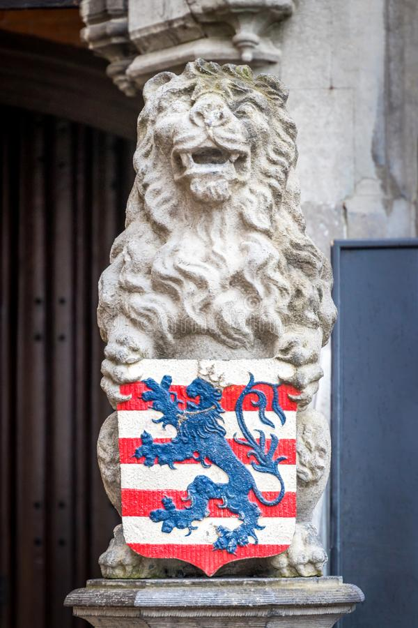 Lion with coat of arms of Bruges at the Grote Markt stock images