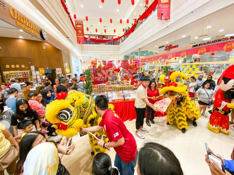 A lion dance held at a shopping mall to celebrate upcoming Chinese New Year. stock photos