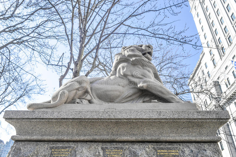 Lion de Belfort, an attribute to Queen Victoria. Dominion Square, downtown, Montreal, Canada royalty free stock images