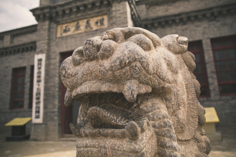 Lion de découpage en pierre en Chine photo libre de droits