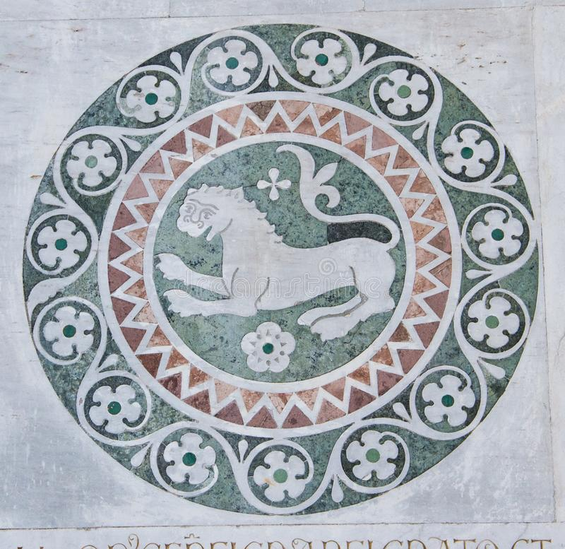Lion in a decorative circle on the Chiesa dei Santi Giovanni e Reparata. Lion in a decorative circle. This is a decorative element on the external walls of a royalty free stock images