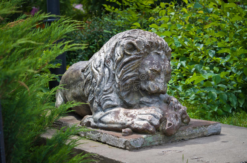 A lion devouring a sheep. Sculpture at the entrance to the temple of Sergius of Radonezh (Russia, Tula) stock photography