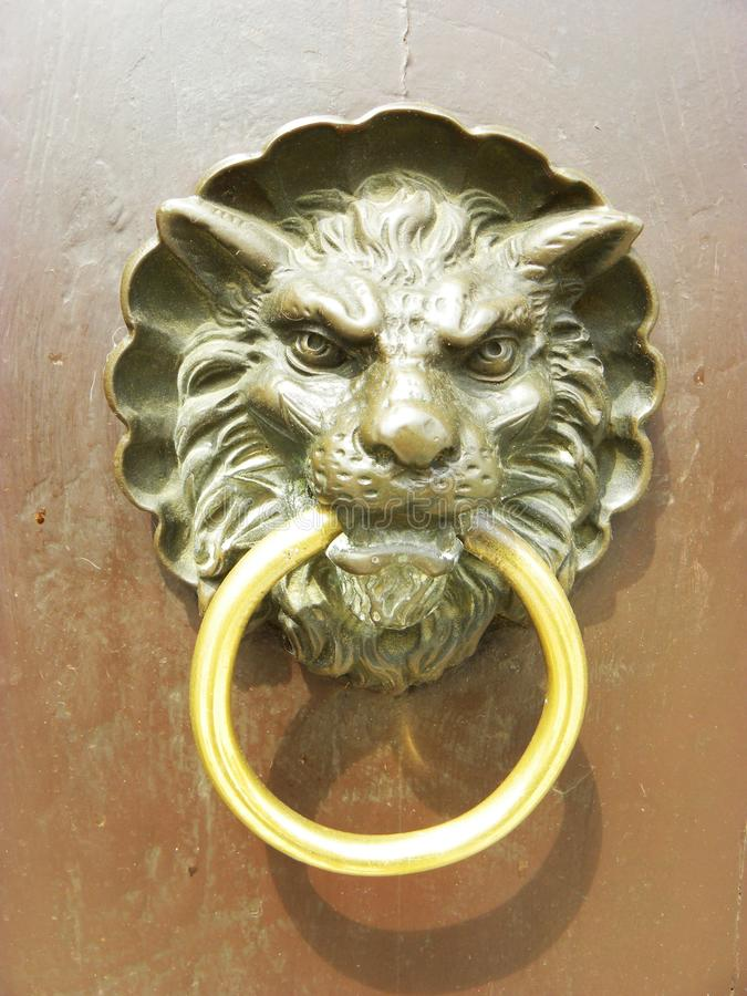 Lion door knocker stock photo