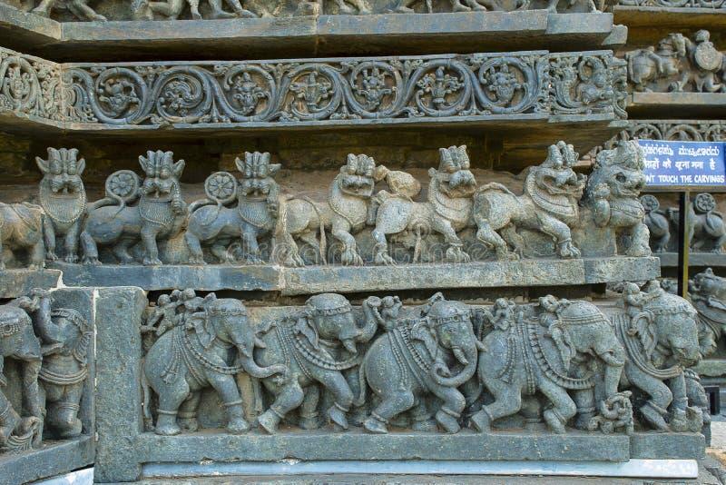 Lion and elephant frieze. Hoysaleswara temple, Halebidu, Karnataka, India. royalty free stock photo