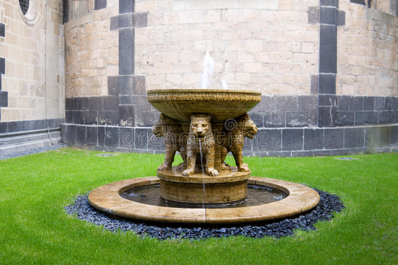 The Lion fountain in the courtyard of the Maria Laach abbey in G. The Maria Laach abbey is a Benedictine abbey situated in the Eifel region of the Rhineland stock photo