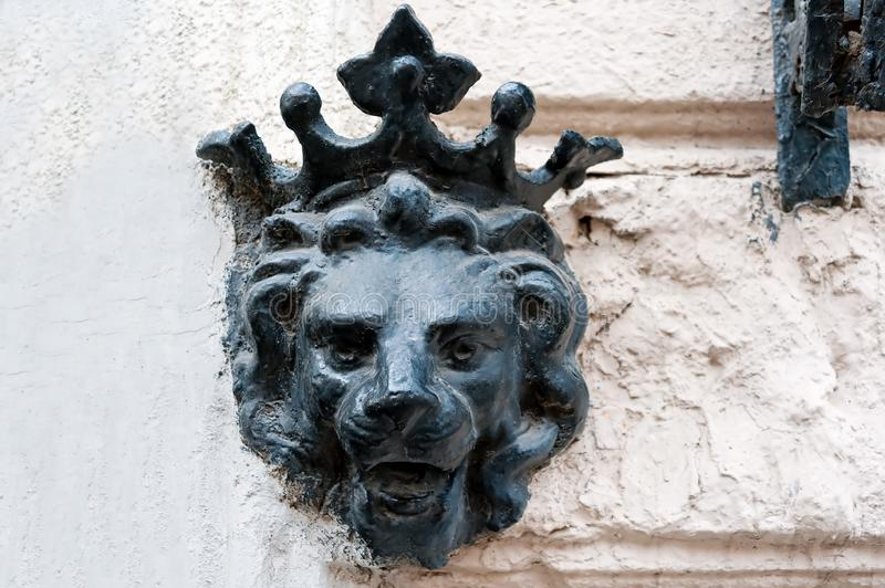 The lion head in the crown in Odesa, Ukraine. The lion head in the crown on the wall of old house in Odesa, Ukraine royalty free stock image