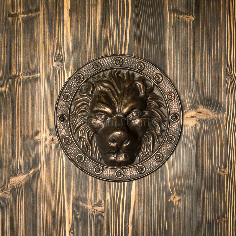 Lion head, decorative detail on the front door royalty free stock image