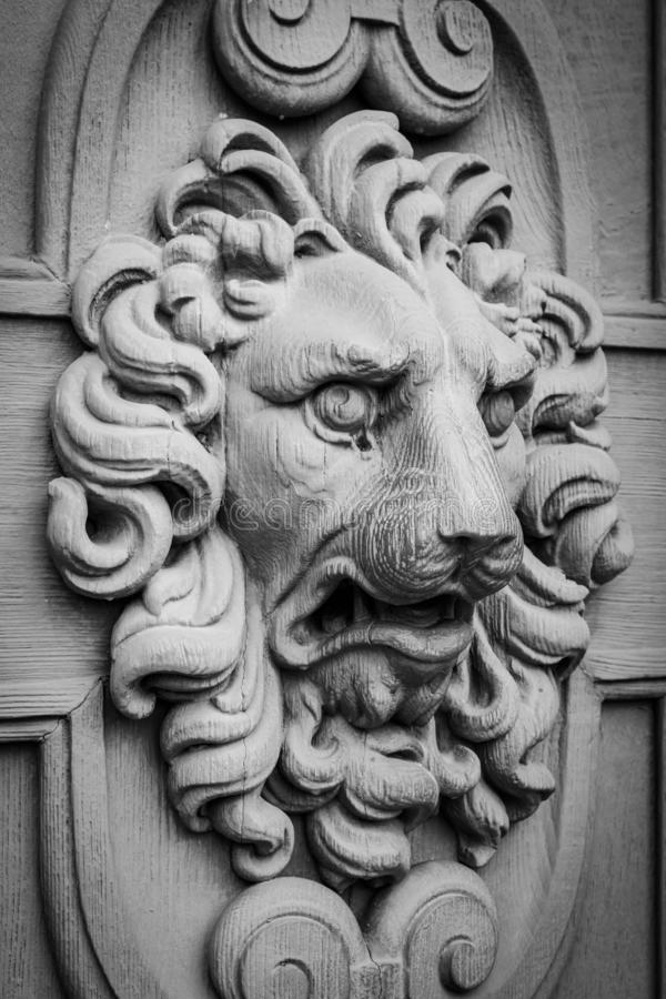 Lion head, decorative element on a wall stock photography