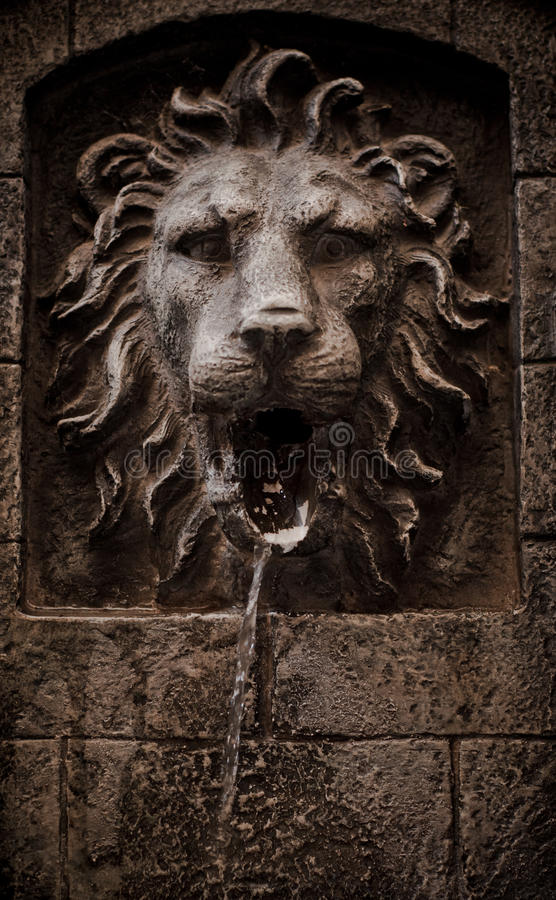 Lion head fountain detail stock photography