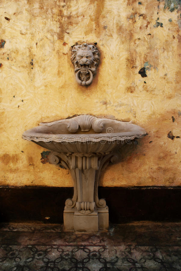 Lion Head water fountain. A lion head waterfountain in Galeria Comercial in Buenos Aires. It is a historical building that was built in 1876 stock images