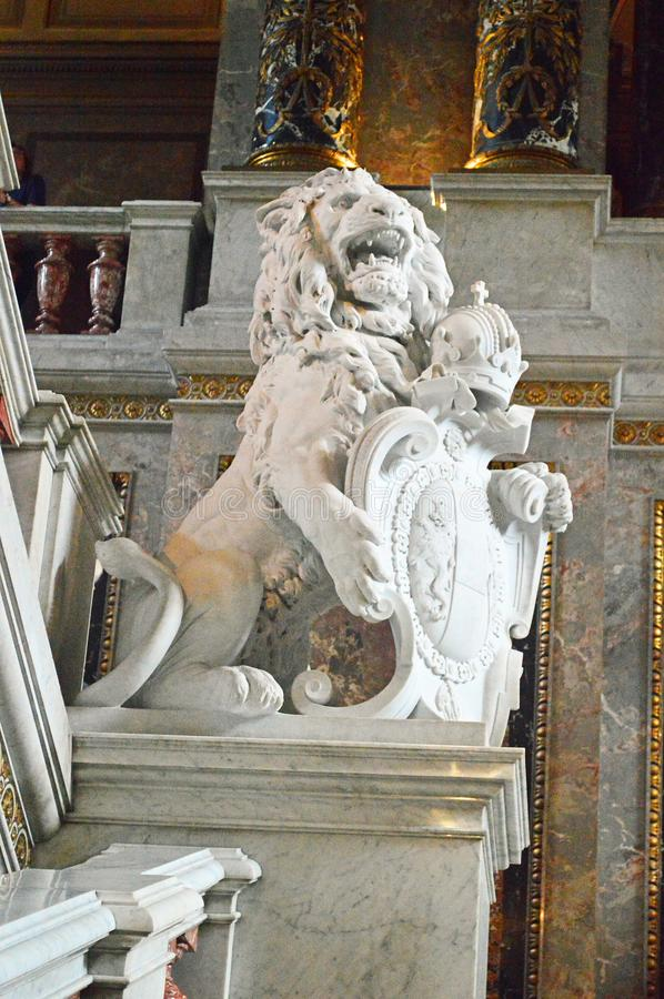 Lion Heraldic white statue at Kunsthistorisches Museum. Heraldic Lion with crown and shield white statue at Kunsthistorisches Museum Vienna, Austria royalty free stock photos