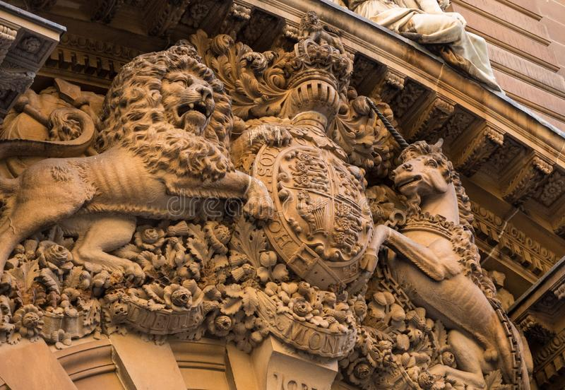 Lion and horse high sculptural relief on a historic building. royalty free stock image