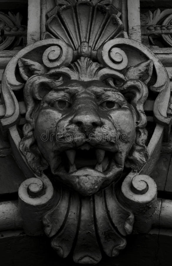 Lion lion. Shot in black and white, detail on an sculpture representing a lion placed on the facade of this historic building, set in Eixample, Barcelona stock image