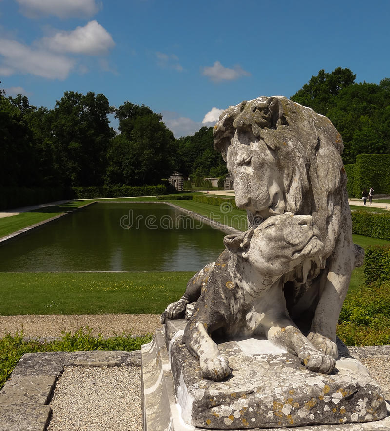Lion and lionnes in garden of Vaux-le-Vicomte, France. The Château de Vaux-le-Vicomte is a baroque French château located in Maincy, near Melun, 55 stock photo