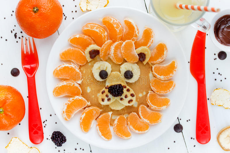 Lion pancakes - funny breakfast idea for kids. Food art composition royalty free stock photography