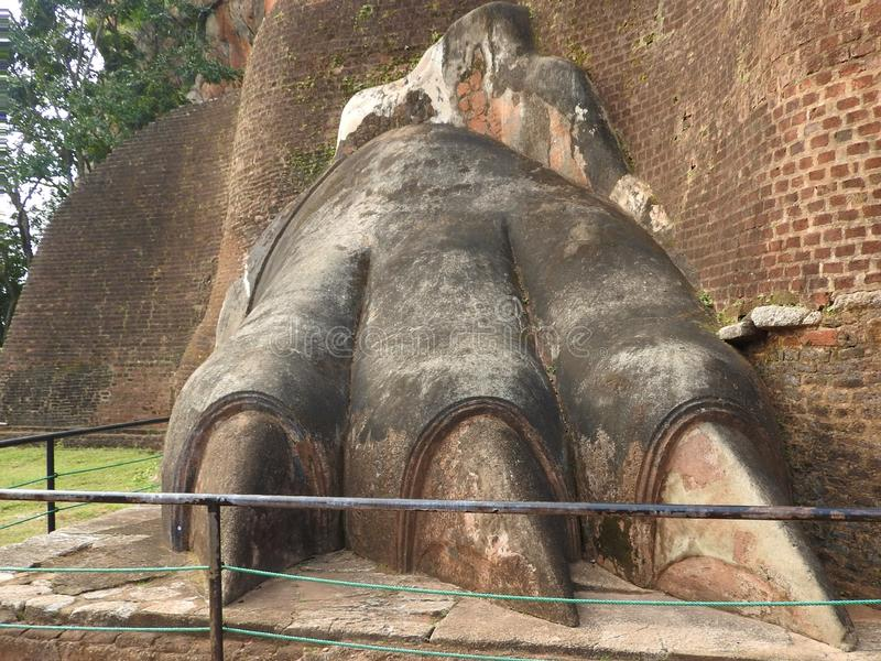 Lion Paws mark the gate to the ancient palace built in the past on the top of Sigiriya rock, the most important historical travel royalty free stock photos