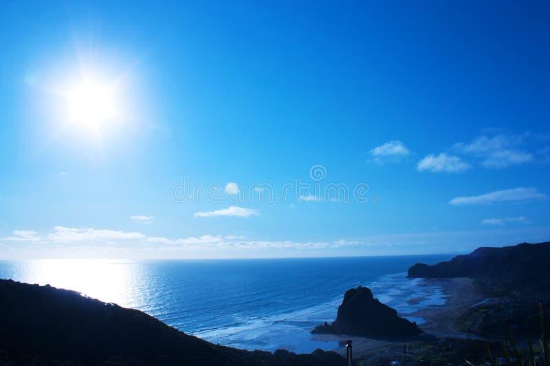 Lion piha rock under blue sunshine. Piha beach in western shore of Auckland, New Zealand royalty free stock photos