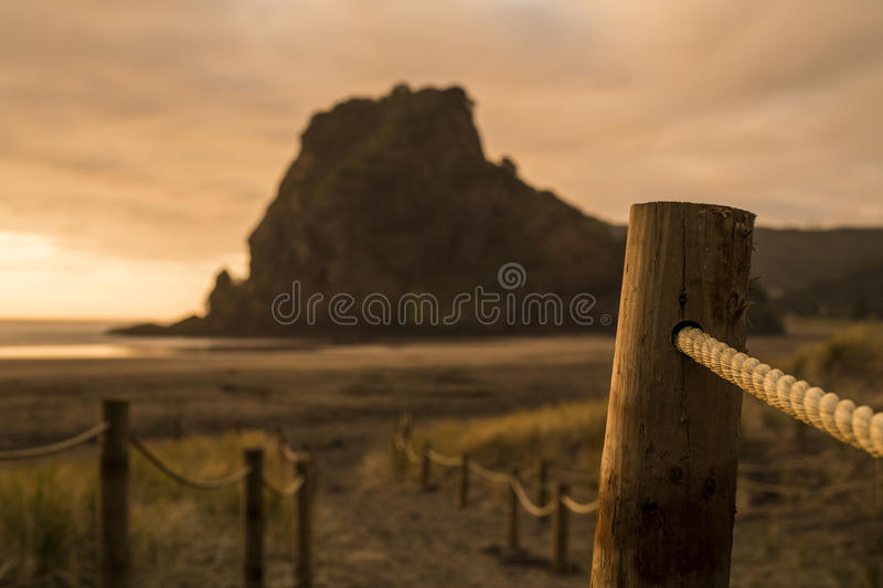 Download Lion rock piha stock image. Image of sunset, rope, sundown - 26410979
