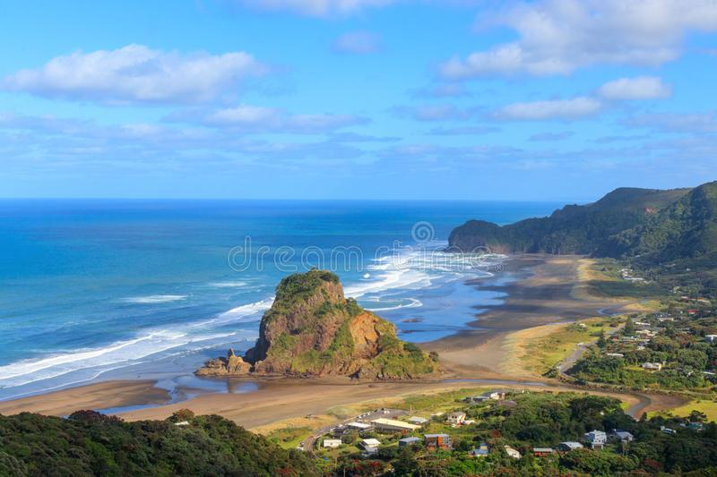 Lion Rock at Piha beach aerial view, New Zealand. Lion Rock at Piha beach near Auckland aerial view, New Zealand royalty free stock images