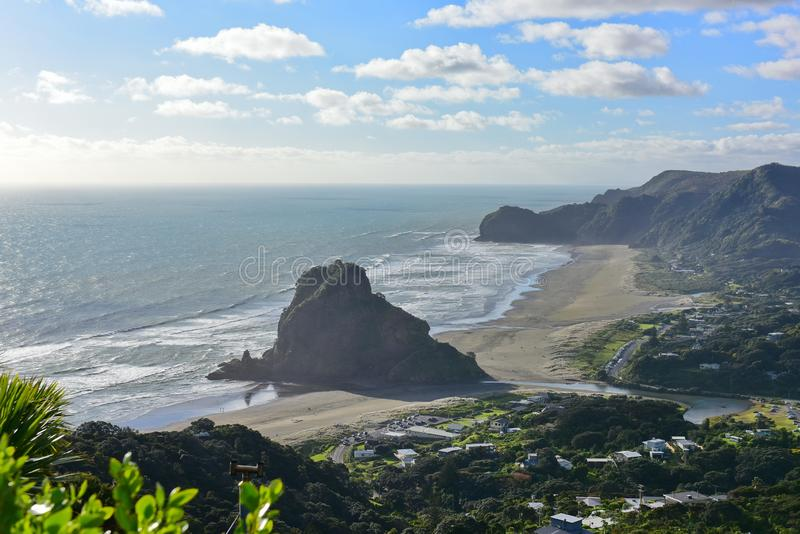 The Lion Rock is Piha Beach`s most iconic landmark, at west coast, New Zealand. The Lion Rock is Piha Beach`s most iconic landmark, at west coast Waitakere, New stock photos