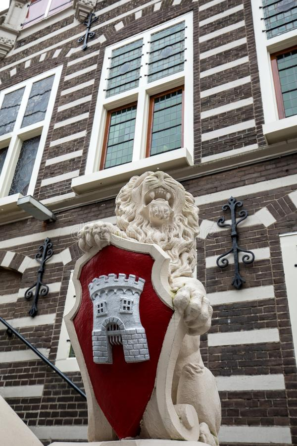 Lion sculpture with coat of arms at Stadthuis, City Hall in Alkmaar, North Holland, The Netherlands royalty free stock photo