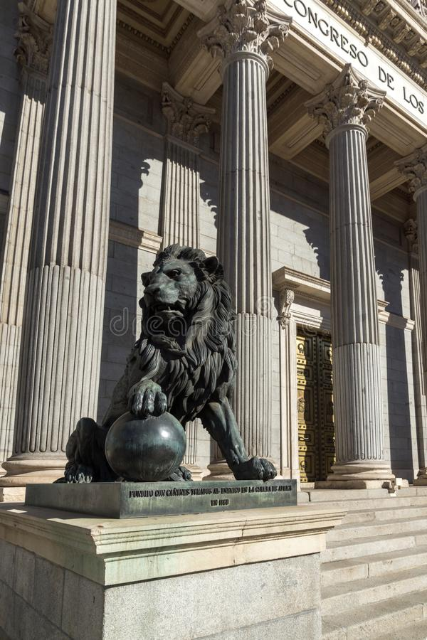 Lion sculpture in front of Building of Congress of Deputies Congreso de los Diputados in City. MADRID, SPAIN - JANUARY 22, 2018: Lion sculpture in front of royalty free stock photography