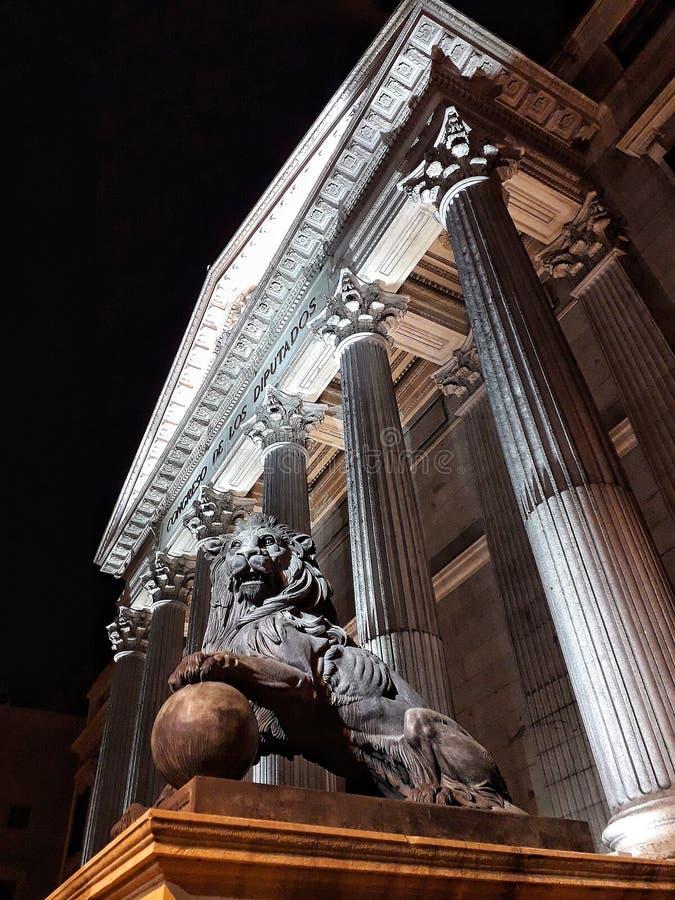 Lion sculpture in front of Pillars Building of Congress of Deputies Congreso de los Diputados in City. Architecture, iberia stock photo
