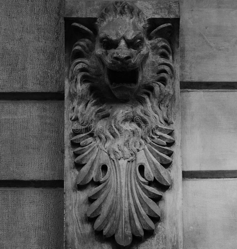 The lion. Shot in black and white. Placed on the facade of this historic building, sculpture representing a lion. Set in Eixample, Barcelona, Catalunya, Spain stock photos