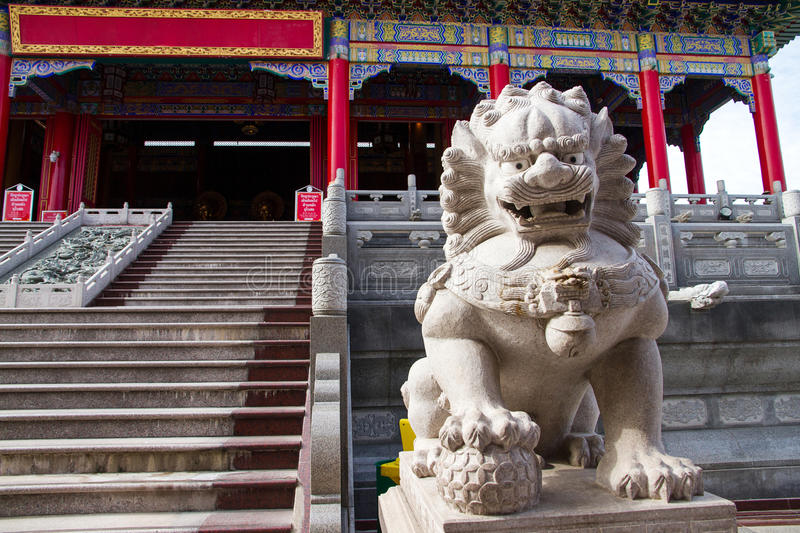 Lion statue with chinese style at that public chinese temple in stock image