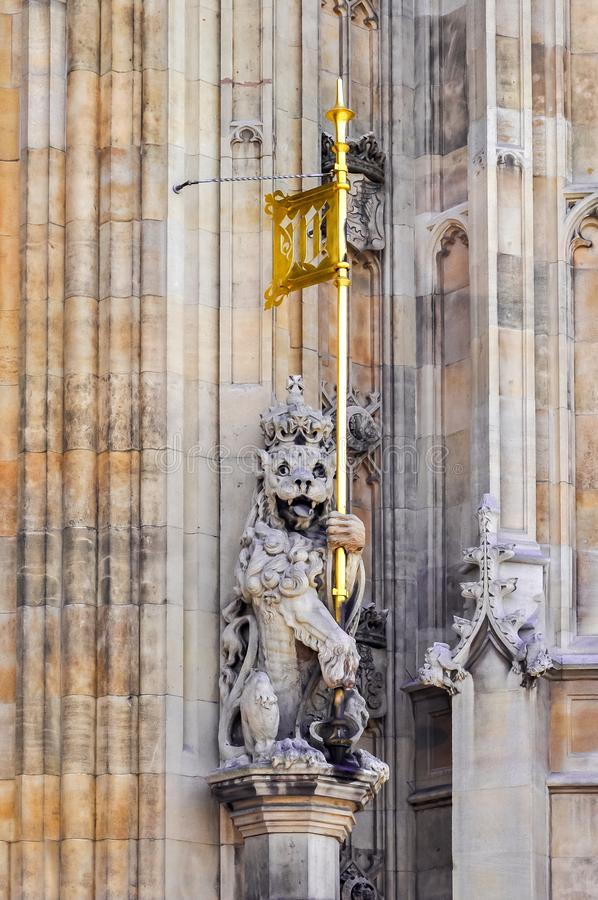 Lion statue with flag on Westminster palace facade, London, UK royalty free stock photos