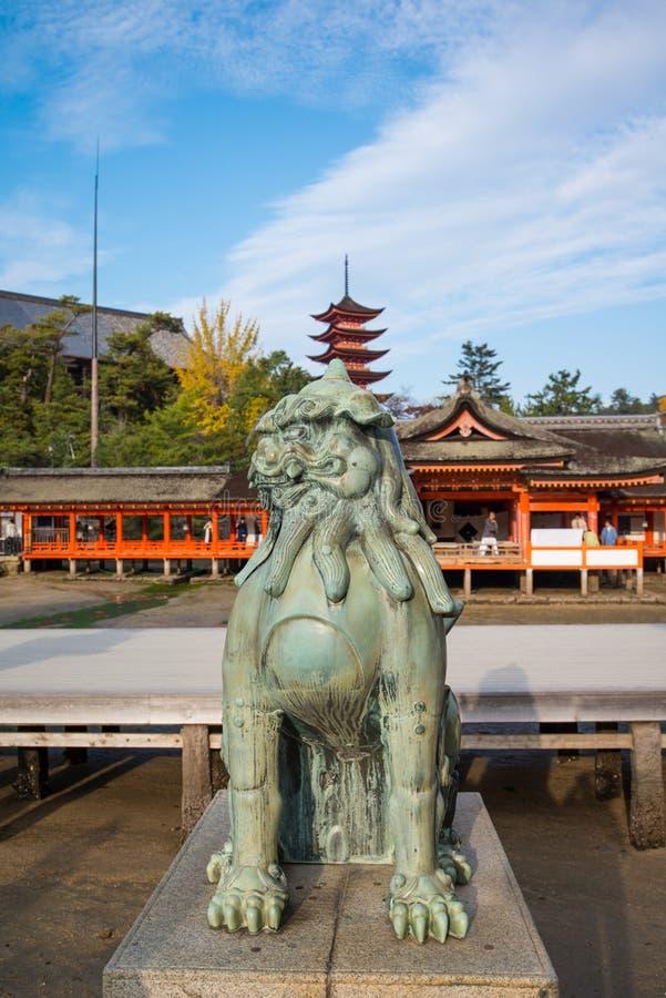 Lion statue at Itsukushima Shrine at Miyajima island. Lion statue at Itsukushima Shinto Shrine complex in Miyajima Island  Hiroshima,Japan royalty free stock photography