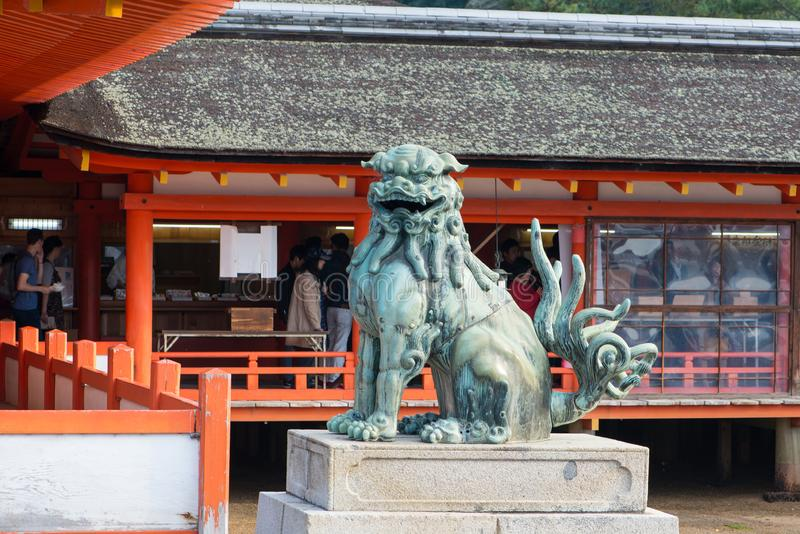 Lion statue at Itsukushima Shrine at Miyajima island. Lion statue at Itsukushima Shinto Shrine complex in Miyajima Island  Hiroshima,Japan royalty free stock photo