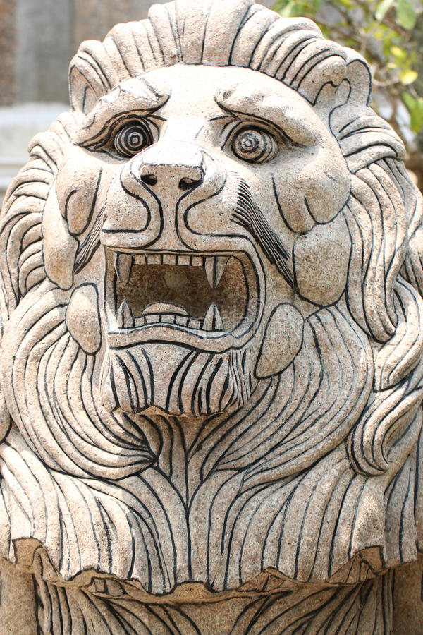 Lion statues carved. Lion statues carved from stone stock photos
