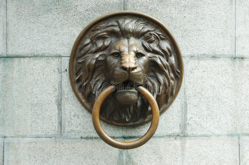 Lionhead oLd door knocker stock photo. Image of entrance - 26059010